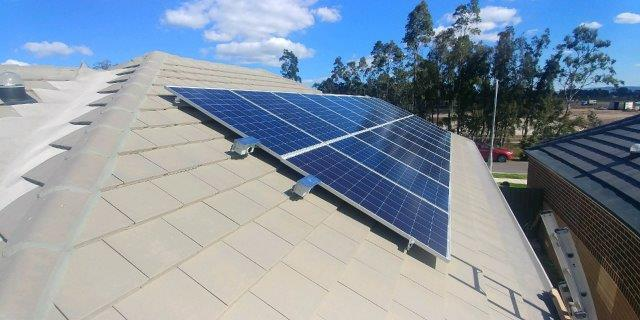 solar panels on house roof under blue sky