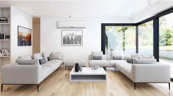 bright living room with white split system air conditioner